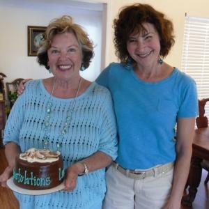 Deb Gaal presents Lou a launch cake Mail-Order Mate crop 7-2012